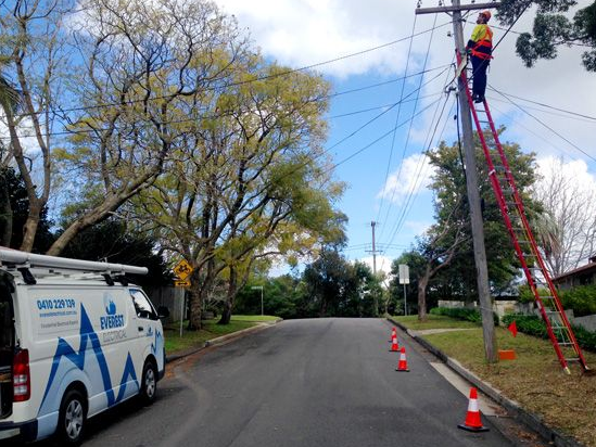 Electrician Doing Level 2 Electrical Work on Power Lines